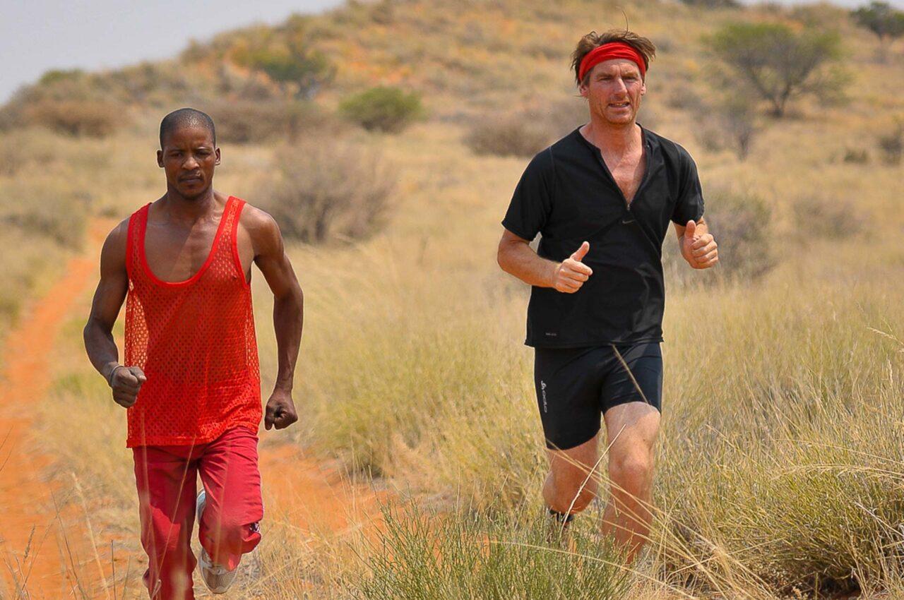 Two runners jogging through the Kalahari desert